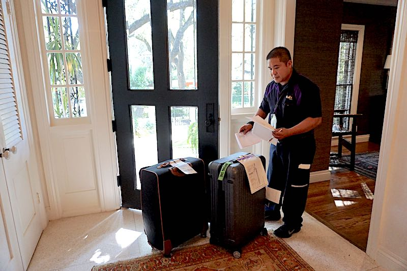 Fed Ex and Luggage Free image